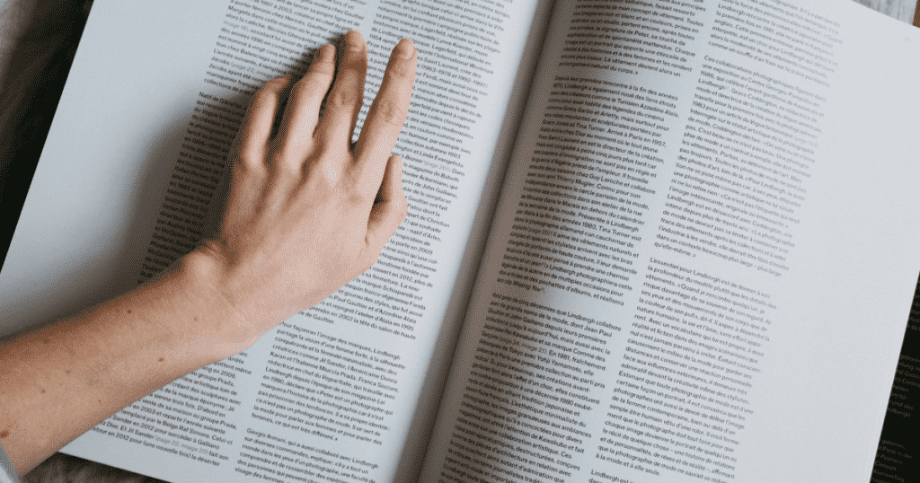 A person pointing something on a book