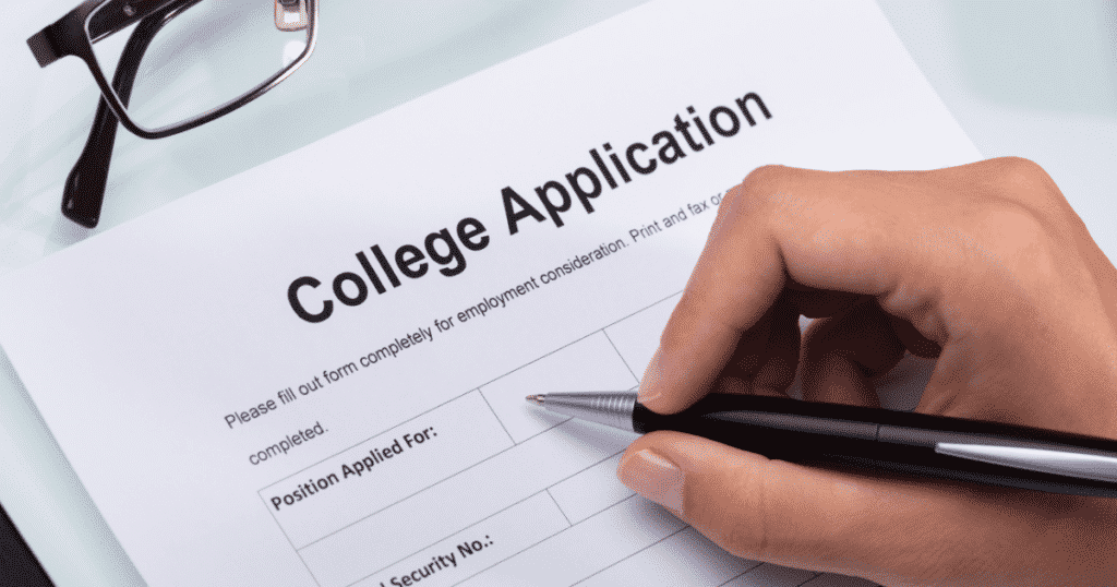 a person filling a college application form