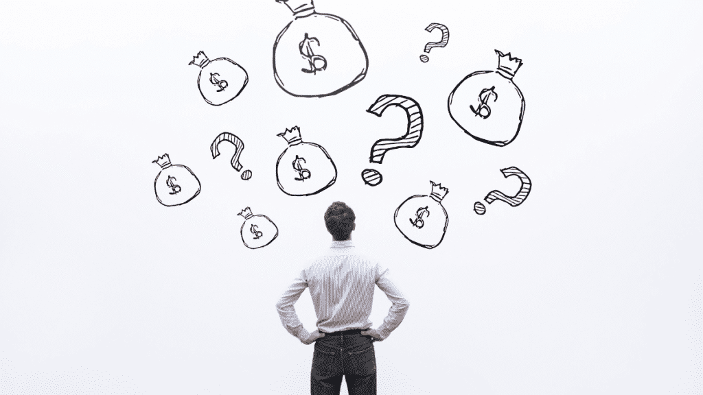 A picture of a man looking at a white surface with money bags and question marks: dissertation topics in finance